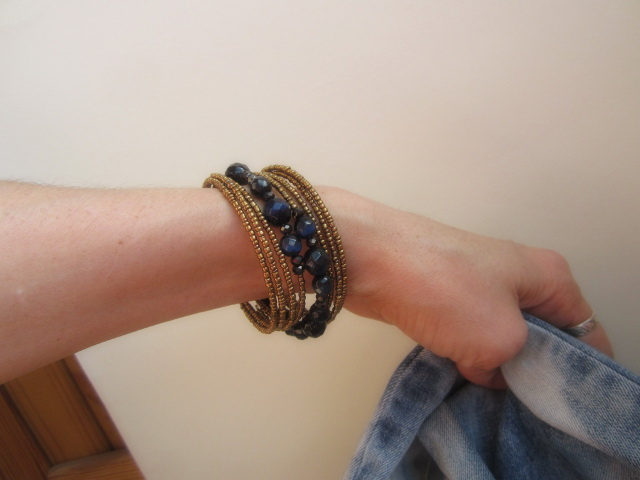 blue-antic gold braslet with jeans