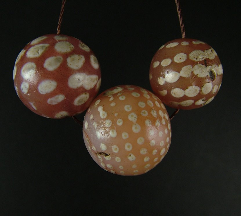 Ancient round decorated carnelians with dot design.