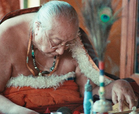 The late Dilgo Kyentse Rinpoche is seen here wearing a necklace of various ancient dZi beads
